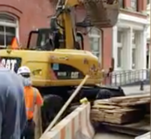 Construction to the Rescue: Workers Use Digger to Stop Looters from Making Off with Stolen Designer Goods